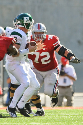 COLUMBUS, OH - SEPTEMBER 25:  Dexter Larimore #72 of the Ohio State Buckeyes chases down quarterback Alex Gillett  #8 of the Eastern Michigan Eagles at Ohio Stadium on September 25, 2010 in Columbus, Ohio.  Ohio State won 73-20. (Photo by Jamie Sabau/Gett