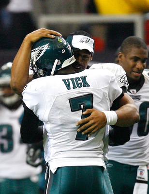 ATLANTA - DECEMBER 06:  Donovan McNabb #5 of the Philadelphia Eagles congratulates Michael Vick #7 after Vick passed for his second touchdown against the Atlanta Falcons at Georgia Dome on December 6, 2009 in Atlanta, Georgia.  (Photo by Kevin C. Cox/Gett
