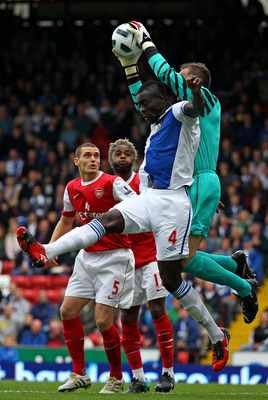 BLACKBURN, ENGLAND - AUGUST 28:  Manuel Almunia of Arsenal claims the ball under pressure from Chris Samba of Blackburn Rovers during the Barclays Premier League match between Blackburn Rovers and Arsenal at Ewood Park on August 28, 2010 in Blackburn, Eng
