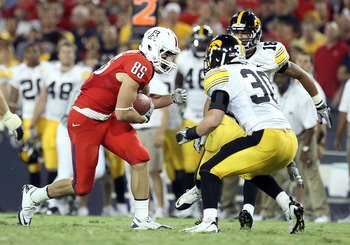 TUCSON, AZ - SEPTEMBER 18:  Wide receiver David Douglas #85 of the Arizona Wildcats runs with the ball after a reception against the Iowa Hawkeyes during the college football game at Arizona Stadium on September 18, 2010 in Tucson, Arizona. The Wildcats d