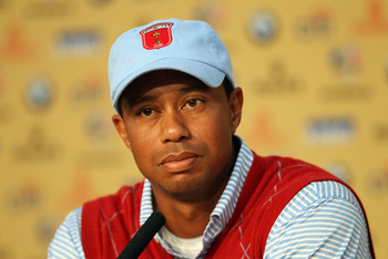 NEWPORT, WALES - SEPTEMBER 28:  Tiger Woods of the USA listens to questions from the media at a press conference following a practice round prior to the 2010 Ryder Cup at the Celtic Manor Resort on September 28, 2010 in Newport, Wales.  (Photo by Ross Kin