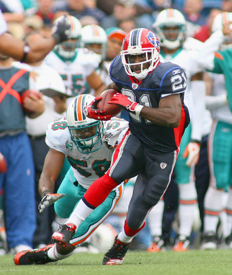 ORCHARD PARK, NY - SEPTEMBER 12:  CJ Spiller #21 of the Buffalo Bills runs away from Karlos Dansby #58 of the Miami Dolphins during the NFL season opener at Ralph Wilson Stadium on September 12, 2010 in Orchard Park, New York. Miami won 15-10. (Photo by R