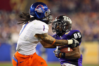 GLENDALE, AZ - JANUARY 04:  Kyle Wilson #1 of the Boise State Broncos attempts to strip the ball from Jeremy Kerley #85 of the TCU Horned Frogs in the third quarter during the Tostitos Fiesta Bowl at the Universtity of Phoenix Stadium on January 4, 2010 i