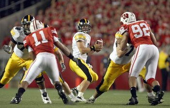 MADISON, WI - SEPTEMBER 22: Jake Christensen#6 of the Iowa Hawkeyes looks to pass the ball during the game against the Wisconsin Badgers at Camp Randall Stadium September 22, 2007 in Madison, Wisconsin. (Photo by Jonathan Daniel/Getty Images)