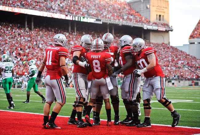 COLUMBUS, OH - SEPTEMBER 2: The Ohio State Buckeyes celebrate a touchdown by DeVier Posey #8 of the Ohio State Buckeyes against the Marshall Thundering Herd at Ohio Stadium on September 2, 2010 in Columbus, Ohio. (Photo by Jamie Sabau/Getty Images)