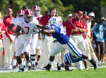 DURHAM, NC - SEPTEMBER 18: Julio Jones #8 of the Alabama Crimson Tide gives a stiff arm to Austin Gamble #45 of the Duke Blue Devils at Wallace Wade Stadium on September 18, 2010 in Durham, North Carolina.  The Crimson Tide defeated the Blue Devils 62-13.