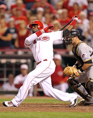 CINCINNATI - SEPTEMBER 11: Brandon Phillips #4 of the Cincinnati Reds swings at a pitch during the game against the Pittsburg Pirates at Great American Ball Park on September 11, 2010 in Cincinnati, Ohio.  (Photo by Andy Lyons/Getty Images)