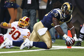 ST. LOUIS - SEPTEMBER 26: Steven Jackson #39 of the St. Louis Rams scores a touchdown against LaRon Landry #30 of the Washington Redskins at the Edward Jones Dome on September 26, 2010 in St. Louis, Missouri.  The Rams beat the Redskins 30-16.  (Photo by