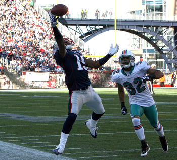 FOXBORO, MA - NOVEMBER 8:  Brandon Tate #19  of the New England Patriots is unable to catch a pass as Jason Allen #32  of the Miami Dolphins defend at Gillette Stadium on November 8, 2009 in Foxboro, Massachusetts. The Patriots won 27-17. (Photo by Jim Ro