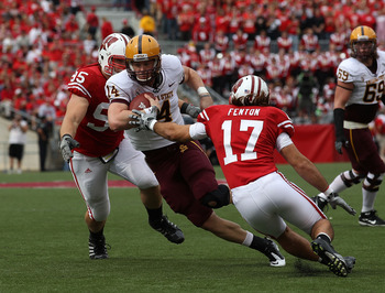 MADISON, WI - SEPTEMBER 18: Steven Threet #14 of the Arizona State Sun Devils tries to move between Patrick Butrym #95 and A.J. Fenton #17 of the Wisconsin Badgers at Camp Randall Stadium on September 18, 2010 in Madison, Wisconsin. Wisconsin defeated Ari
