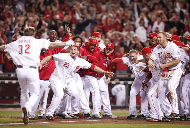 CINCINNATI, OH - SEPTEMBER 28: The Cincinnati Reds celebrate Jay Bruce's walk off home run against the Houston Astros at Great American Ball Park on September 28, 2010 in Cincinnati, Ohio. The Reds won 3-2 to clinch the NL Central Division title. (Photo b