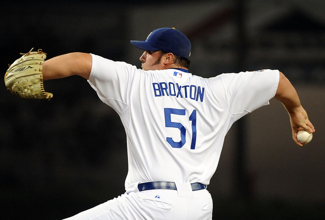 LOS ANGELES, CA - SEPTEMBER 17:  Jonathan Broxton #51 of the Los Angeles Dodgers pitches against the Colorado Rockies at Dodger Stadium on September 17, 2010 in Los Angeles, California.  (Photo by Lisa Blumenfeld/Getty Images)