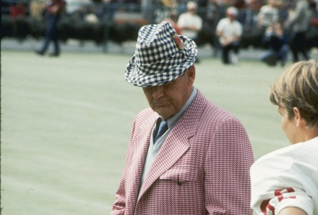 Coach Bear Bryant of the Alabama Crimson Tide watches his players during a game.