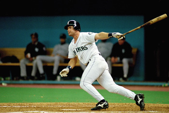 SEATTLE - OCTOBER 8:  Edgar Martinez #11 of the Seattle Mariners doubles home the game winning runs in Game five of the 1995 American League Divisional Series against the New York Yankees at the Kingdome on October 8, 1995 in Seattle, Washington. The Mari