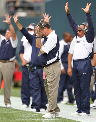 SEATTLE - SEPTEMBER 26:  Head coach Norv Turner of the San Diego Chargers holds his head during the game against the Seattle Seahawks at Qwest Field on September 26, 2010 in Seattle, Washington. The Seahawks defeated the Chargers 27-20. (Photo by Otto Gre