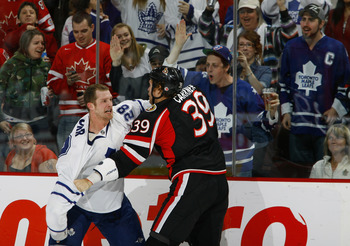 OTTAWA, ON - MARCH 6:  Colton Orr #28 of the Toronto Maple Leafs and Matt Carkner #39 of the Ottawa Senators fight in front a a group of excited fans in a game at Scotiabank Place on March 6, 2010 in Ottawa, Canada. (Photo by Phillip MacCallum/Getty Image