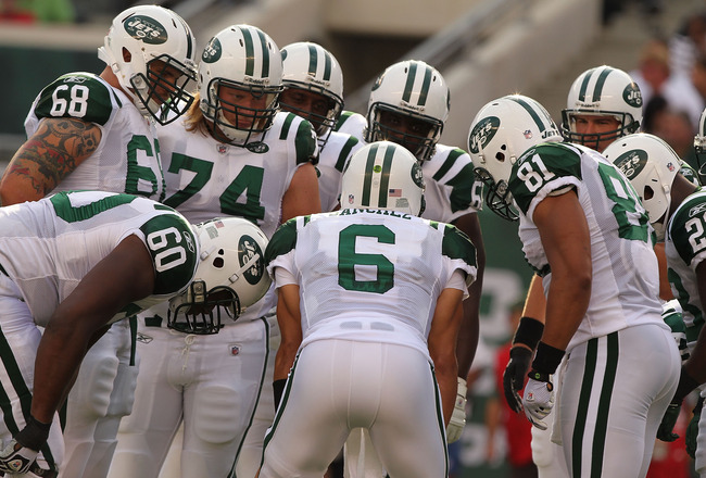 EAST RUTHERFORD, NJ - SEPTEMBER 19:  Mark Sanchez #6 of the New York Jets calls the huddle against  the New England Patriots during their  game on September 19, 2010 at the New Meadowlands Stadium  in East Rutherford, New Jersey.  (Photo by Al Bello/Getty