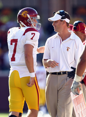 MINNEAPOLIS - SEPTEMBER 18:  Head coach Lane Kiffin of the USC Trojans congratulates quarterback Matt Barkley #7 after a touchdown during the game against the Minnesota Golden Gophers on September 18, 2010 at TCF Bank Stadium in Minneapolis, Minnesota.  (