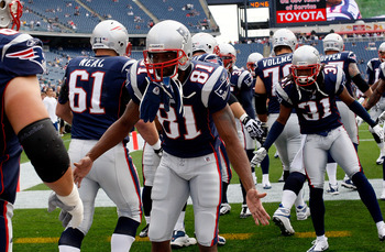 FOXBORO, MA - SEPTEMBER 26:  Randy Moss #81 of the New England Patriots greets teammates during drills before a game against the Buffalo Bills at Gillette Stadium on September 26, 2010 in Foxboro, Massachusetts. (Photo by Jim Rogash/Getty Images)