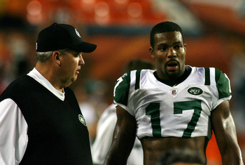 MIAMI - SEPTEMBER 26:  Receiver Braylon Edwards #17 and head coach Rex Ryan (L) of the New York Jets chat during warms up prior to playing the Miami Dolphins at Sun Life Stadium on September 26, 2010 in Miami, Florida.  (Photo by Marc Serota/Getty Images)