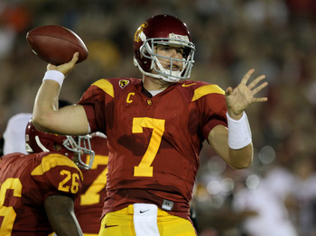 LOS ANGELES - SEPTEMBER 11:  Quarterback Matt Barkley #7 of the USC Trojans throws a pass against the Virginia Cavaliers at Los Angeles Memorial Coliseum on September 11, 2010 in Los Angeles, California. (Photo by Stephen Dunn/Getty Images)