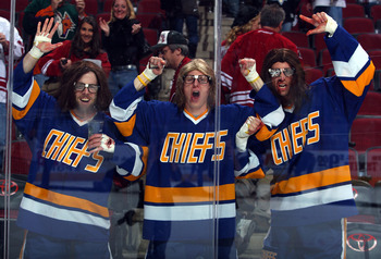 GLENDALE, AZ - JANUARY 14:  Fans dressed as the Hanson Brothers cheer along the boards following the NHL game between the New Jersey Devils and the Phoenix Coyotes at Jobing.com Arena on January 14, 2010 in Glendale, Arizona.  The Coyotes defeated the Dev