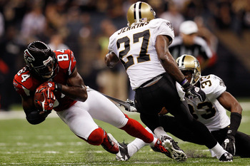 NEW ORLEANS - SEPTEMBER 26:  Roddy White #84 of the Atlanta Falcons is tackled by Malcom Jenkins #27 of the New Orleans Saints at the Louisiana Superdome on September 26, 2010 in New Orleans, Louisiana.  The Falcons defeated the Saints 27-24.  (Photo by C