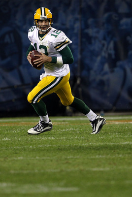 CHICAGO - SEPTEMBER 27:  Aaron Rodgers #12 of the Green Bay Packers rolls out to pass against the Chicago Bears at Soldier Field on September 27, 2010 in Chicago, Illinois. The Bears won 20-17.  (Photo by Jonathan Daniel/Getty Images)