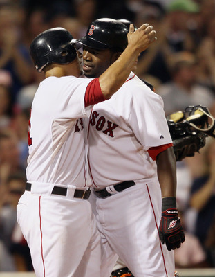 BOSTON - SEPTEMBER 22: David Ortiz #34 of the Boston Red Sox is congratulated by teammate Victor Martinez #41 after Ortiz hit a three run homer in the bottom of the fourth inning against the Baltimore Orioles on September 22, 2010 at Fenway Park in Boston
