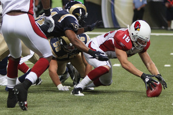 ST. LOUIS - SEPTEMBER 12: Max Komar #18 of the Arizona Cardinals recovers his own fumble against the St. Louis Rams during the NFL season opener at the Edward Jones Dome on September 12, 2010 in St. Louis, Missouri.  The Cardinals beat the Rams 17-13.  (P