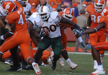 University of Miami   running back Tyrone Moss rushes for a gain against Clemson September 17, 2005 at Clemson. (Photo by A. Messerschmidt/Getty Images)