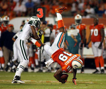 MIAMI - SEPTEMBER 26:  ReceiverBrandon Marshall #19 of the Miami Dolphins makes a carch against the New York Jets at Sun Life Stadium on September 26, 2010 in Miami, Florida.  (Photo by Marc Serota/Getty Images)