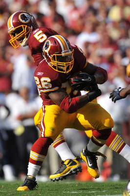 LANDOVER, MD - SEPTEMBER 19:  Clinton Portis #26 of the Washington Redskins runs the ball during the game against the Houston Texans at FedExField on September 19, 2010 in Landover, Maryland. The Texans defeated the Redskins in overtime 30-27. (Photo by L