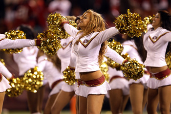 SAN FRANCISCO - SEPTEMBER 20:  The Gold Rush San Francisco 49ers cheerleaders cheer for their team during their game against the New Orleans Saints at Candlestick Park on September 20, 2010 in San Francisco, California.  (Photo by Ezra Shaw/Getty Images)