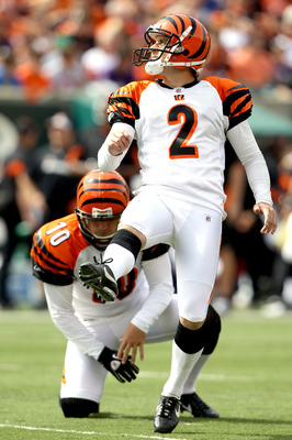 CINCINNATI - SEPTEMBER 19: Mike Nugent #2 of the Cincinatti Bengals kicks a field goal against the Baltimore ravens at Paul Brown Stadium on September 19, 2010 in Cincinnati, Ohio. The holder is Kevin Huber #10.  (Photo by Matthew Stockman/Getty Images)