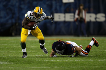 CHICAGO - SEPTEMBER 27:  Brandon Jackson #32 of the Green Bay Packers runs the ball against Brian Urlacher #54 of the Chicago Bears at Soldier Field on September 27, 2010 in Chicago, Illinois.  (Photo by Jonathan Daniel/Getty Images)