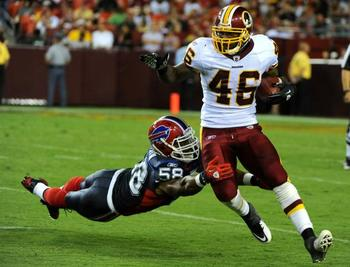 Redskins-ryan-torain-runs-for-a-5-yard-in-washington_4_display_image
