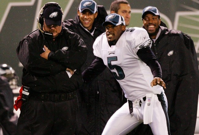 EAST RUTHERFORD, NJ - SEPTEMBER 01:  Donovan McNabb #5 of the Philadelphia Eagles 'dances' for head coach Andy Reid (L) during a time out against the New York Jets during their preseason game at Giants Stadium September 01, 2006 in East Rutherford, New Je