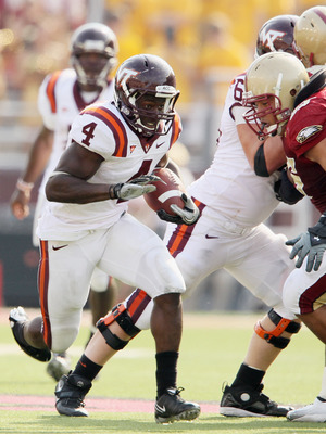 CHESTNUT HILL, MA - SEPTEMBER 25:  David Wilson #4 of the Virginia Tech Hokies carries the ball in the fourth quarter against the Boston College Eagles on September 25, 2010 at Alumni Stadium in Chestnut Hill, Massachusetts. Virginia Tech defeated Boston