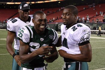 EAST RUTHERFORD, NJ - SEPTEMBER 03:  Lito Sheppard #26 of the New York Jets jokes with former teammates Sheldon Brown #24 and Darren Howard #90 of the Philadelphia Eagles after their game on September 3, 2009 at Giants Stadium in East Rutherford, New Jers