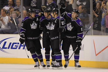 LOS ANGELES, CA - SEPTEMBER 28:  (L-R) Anze Kopitar #11, Ryan Smyth #94, Dustin Brown #23 and Drew Doughty #8 of the Los Angeles Kings celebrate Smyth's first period goal against the Anaheim Ducks at Staples Center on September 28, 2010 in Los Angeles, Ca
