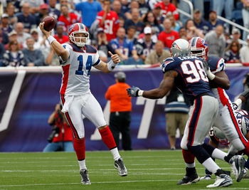 FOXBORO, MA - SEPTEMBER 26:  Quarterback Ryan Fitzpatrick #14 of the Buffalo Bills looks for an open man in the second half against the New England Patriots at Gillette Stadium on September 26, 2010 in Foxboro, Massachusetts. (Photo by Jim Rogash/Getty Im