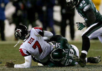 PHILADELPHIA - JANUARY 23:  Quarterback Michael Vick #7 of the Atlanta Falcons is sacked by Derrick Burgess #56 of Philadelphia Eagles during the NFC Championship game at Lincoln Financial Field on January 23, 2005 in Philadelphia, Pennsylvannia.  (Photo