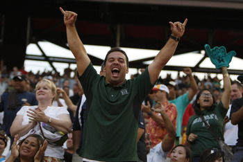 HONOLULU - SEPTEMBER 02: Fans cheer during first half action at Aloha Stadium September 2, 2010 in Honolulu, Hawaii. (Photo by Kent Nishimura/Getty Images)