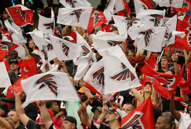 ATLANTA - SEPTEMBER 19:  Fans of the Atlanta Falcons wave flags during the game against the Arizona Cardinals at Georgia Dome on September 19, 2010 in Atlanta, Georgia.  (Photo by Kevin C. Cox/Getty Images)