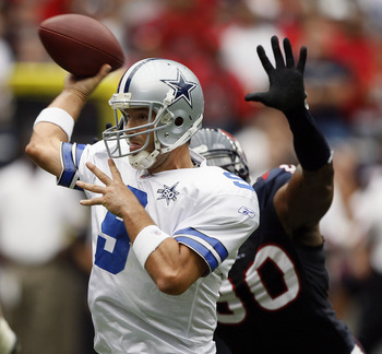 HOUSTON - SEPTEMBER 26:  Quarterback Tony Romo #9 of the Dallas Cowboys releases the ball as he is pressured by defensive end Marion Williams #90 of the Houston Texans at Reliant Stadium on September 26, 2010 in Houston, Texas.  (Photo by Bob Levey/Getty