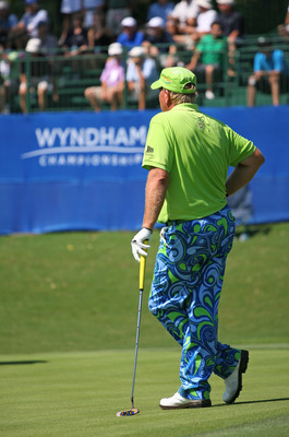GREENSBORO, NC - AUGUST 20: John Daly stands on the 15th green during the second round of the Wyndham Championship at Sedgefield Country Club on August 20, 2010 in Greensboro, North Carolina. (Photo by Hunter Martin/Getty Images)