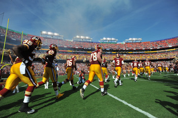 LANDOVER, MD - SEPTEMBER 19:  The Washington Redskins run onto the field before the game against the Houston Texans at FedExField on September 19, 2010 in Landover, Maryland. The Texans defeated the Redskins in overtime 30-27. (Photo by Larry French/Getty
