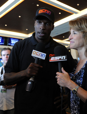 MIAMI GARDENS, FL - FEBRUARY 02:  Chad Ochocinco of the Cincinnati Bengals is interview by Suzy Kolber of ESPN during Super Bowl XLIV Media Day at Sun Life Stadium on February 2, 2010 in Miami Gardens, Florida.  (Photo by Michael Heiman/Getty Images)