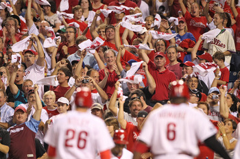 PHILADELPHIA - SEPTEMBER 25: Fans cheer second baseman Chase Utley #26 and first baseman Ryan Howard #6 of the Philadelphia Phillies after Howard's two-run home run in the first inning of a game against the New York Mets at Citizens Bank Park on September